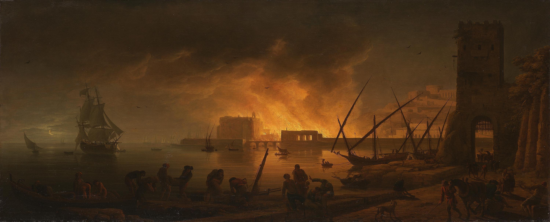 Nächtlicher Brand in einem Seehafen