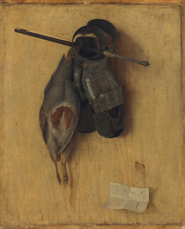 Totes Rebhuhn mit Eisenhandschuhen und Armbrustbolzen