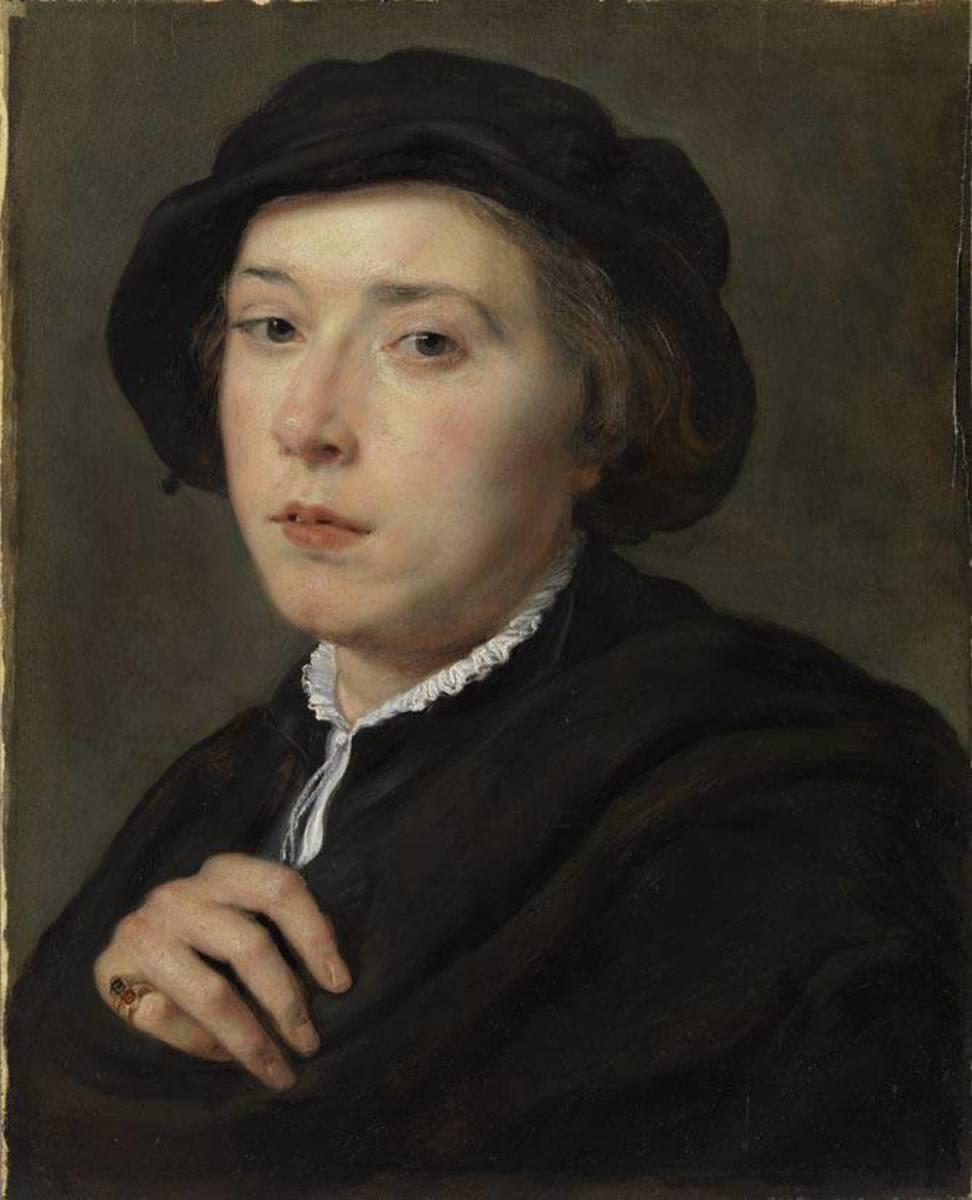 Junger Mann mit schwarzem Barett