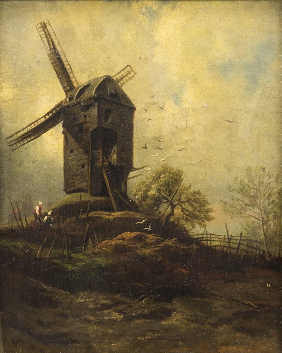 Alte Mühle gegen Wolkenhimmel