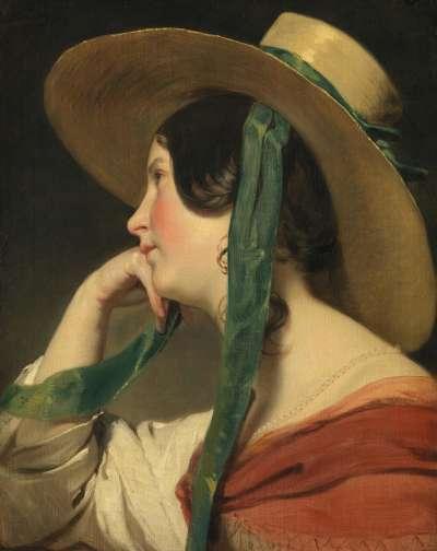 Junges Mädchen mit Strohhut
