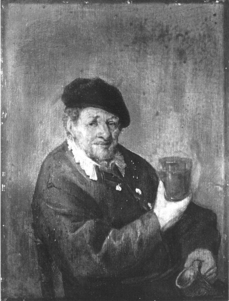 Mann in rotbraunem Gewand