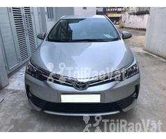 Cần bán gấp xe Toyota Corolla Altis 1.8E màu bạc số tự động đời 2017