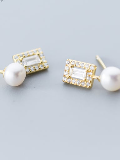 Simple cubic zircons of pure silver and imitation pearl earrings