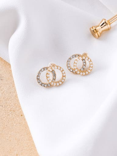 A white diamond (ring type) Alloy With Imitation Gold Plated Simplistic Hollow Geometric Stud Earrings