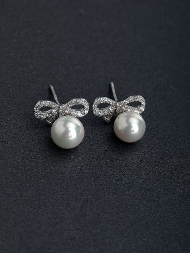 Micro inlay Rhinestone Bowknot Imitation pearls 925 silver Stud earrings