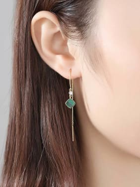 Sterling Silver with natural turquoise ear studs.