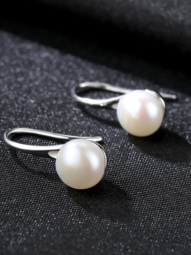 Sterling silver spoon shaped 6-7mm natural freshwater pearl eardrop earring