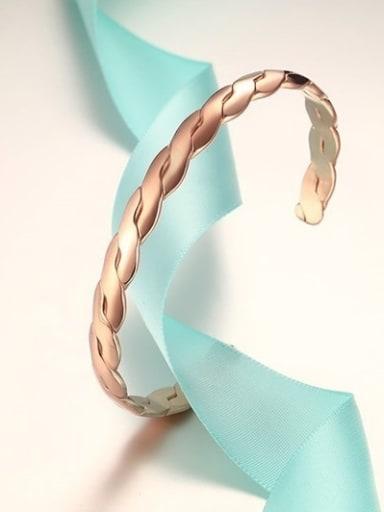 Elegant Rose Gold Plated Twisted Titanium Bangle