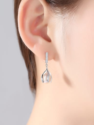 Sterling silver with 3A zircon natural freshwater pearl buds earrings.