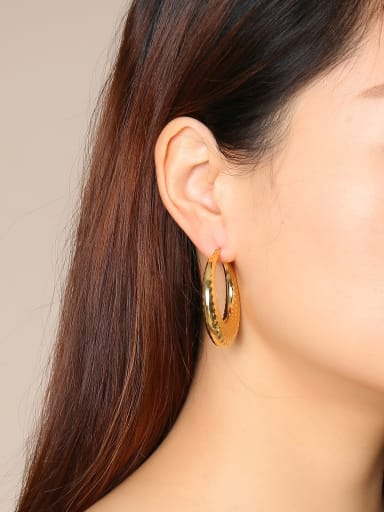 Stainless Steel With Gold Plated Simplistic Hollow Wave Point  Round Hoop Earrings