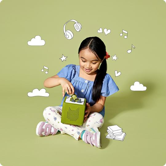 Girl with green toniebox