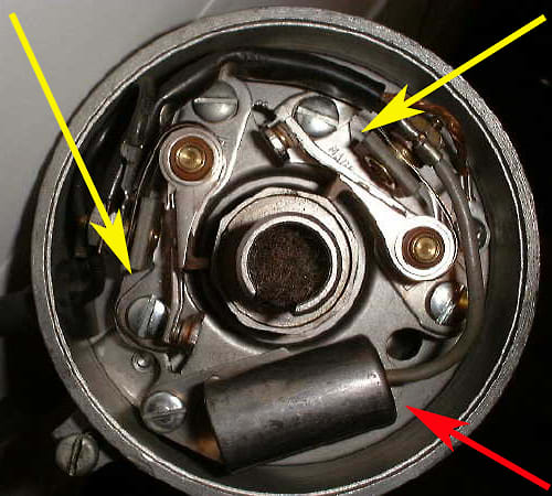 Top view of ignition distributor showing points (yellow arrow) and condensor (red arrow). These parts would require regular replacement to keep your car running properly. This dual point distributor was found on high performance engines.
