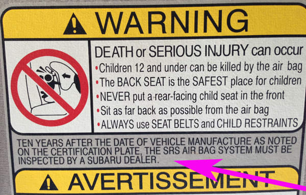 Airbag system warning label as found in 2001 Subaru Outback. How important is it to heed this warning? On this car, as long as the warning lamp goes off a few seconds after start up then it's all systems go and not likely needing any dealer inspection.
