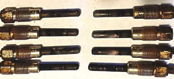 GMC diesel glow plugs: several of these glow plugs were dead and can be noted by the excessive carbon deposits on several plugs