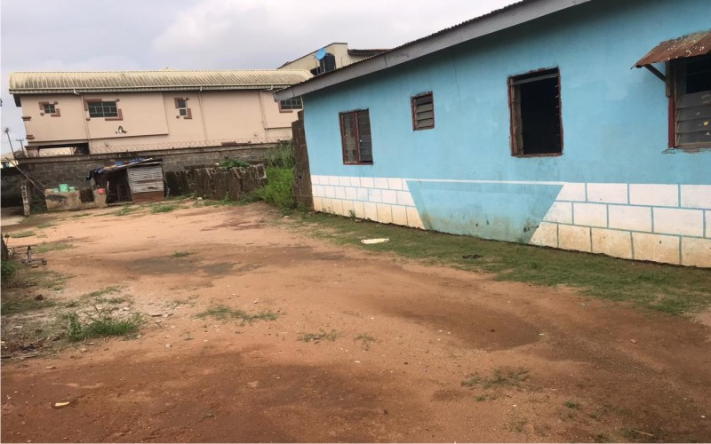 A plot of land with an uncompleted building available for sale at Isheri Oshun Ikotun