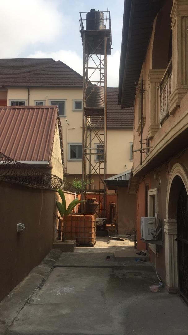 2 stories Apartment house with 4 units of 3 bedroom flats for sale at Ago Palace way, Okota, Lagos