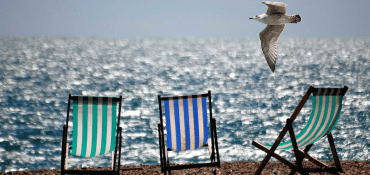 TM Edit: 5 Branded Beach Items That Will Make A Splash This Summer