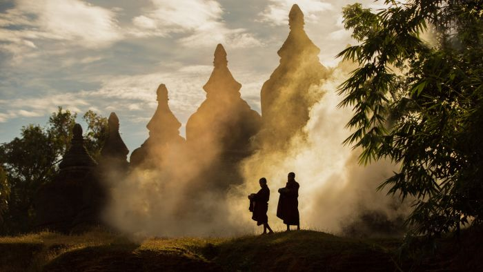 Myanmar-Monks-in-front-of-Pagodas