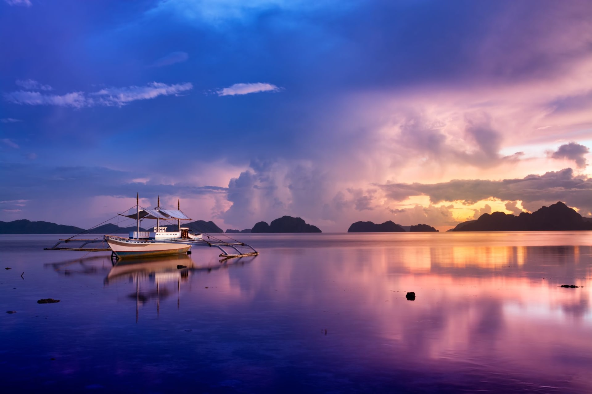 Palawan El Nido tropical sunset with a banca boat