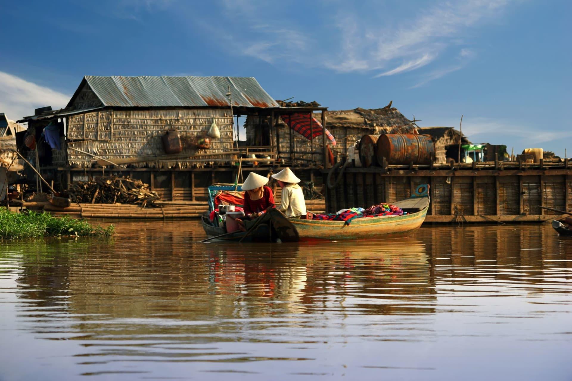 Tonle Sap women sail on a boat