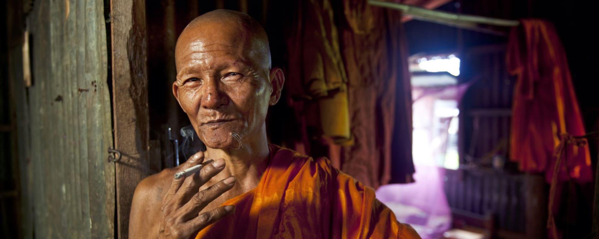 Voyages en Cambodge | Vacances en Asie par tourasia: Monk with cigarette