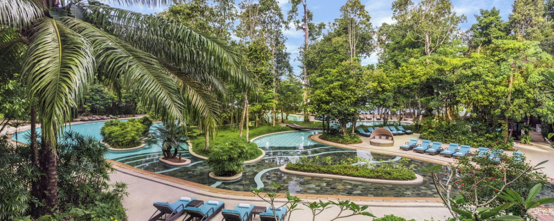 The Andaman à Langkawi: Landscaped swimming pool with sun beds