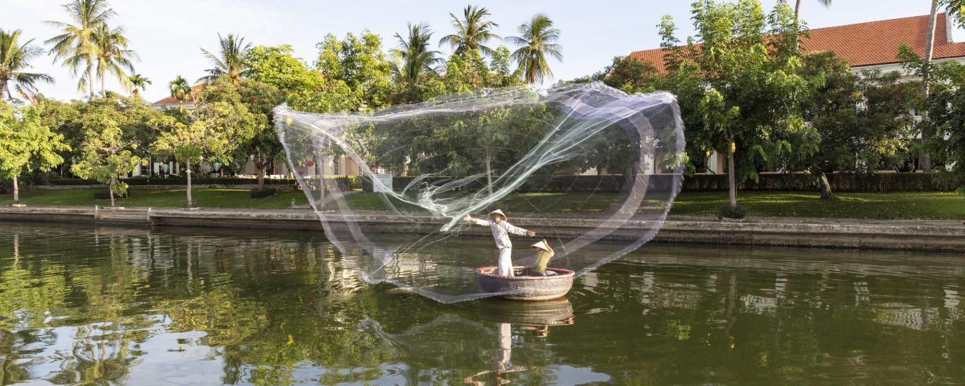 Anantara Hoi An Resort: Fisherman at the Resort Riverfront