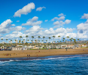 Waves in the Pacific Ocean and view of the beach from Balboa Pier in Newport Beach USA