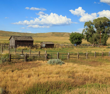 Old Ranch Barns and field near Craig, Colorado, USA