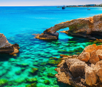 Beautiful natural rock arch near of Ayia Napa Cavo Greco and Protaras on Cyprus island Mediterranean Sea. Legendary bridge lovers.