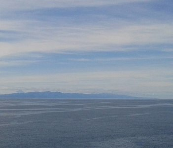 Beyond the horizon (S. Jorge and Pico islands seen from S. Bartolomeu, Terceira)