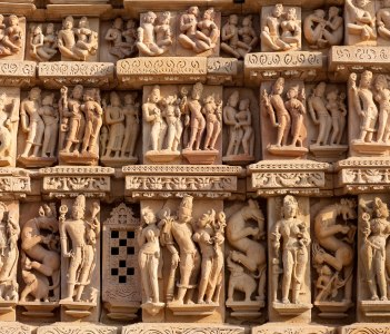 Ancient bas-relief at famous erotic temple in Khajuraho, India.
