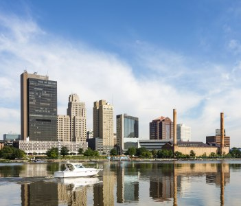 View of downtown Toledo Ohio's skyline reflecting into the Maumee river in USA