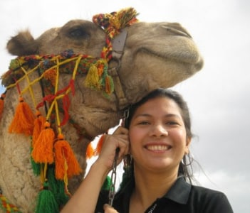 Happy camel and tourist