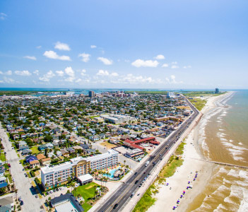 Flying over Galveston Sea Wall and Beach in USA