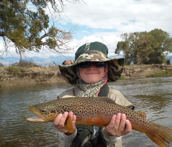 Getin' em started young...nice Ruby River brown trout