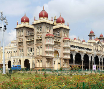 people walking and visiting the Mysore Palace on India