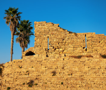 Ruined wall of ancient city Caesarea in Israel