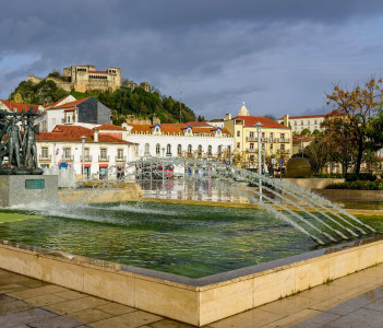 the Central area of the city with the fountain and the old castle of Leiria (Leiria castelo de) in January 6, 2016 in Leiria, Portugal.
