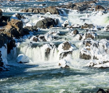 Great Falls on Potomac river outside Washington DC in winter with ice forming on the cascades and snow on the rocks.