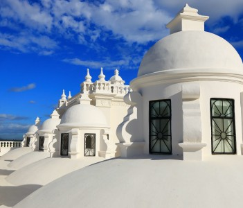 White domes on the roof of Leon Cathedral, Nicaragua - a major tourist attraction during the height of the Christmas season