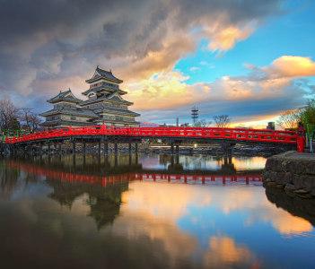 Matsumoto castle and red bridge in Nagano, Japan