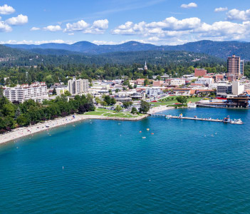 Aerial view of the beach with families enjoying the sunshine and lake in Coeur d' Alene Idaho