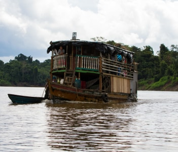 Amazon slow-boat chugs along a remote stretch of the river in Requena, Peru