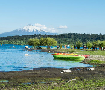 View of Volcan Villarrica from Villarrica lake and people enjoying summer, Chile