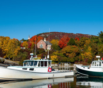 Lobster boats in Camden Maine Harbor fall foliage