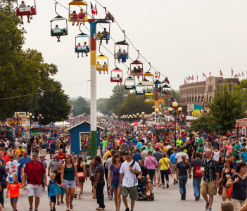Attendees at the Iowa State Fair. Thousands of people filling the midway at the Iowa State Fair in Des Moines Iowa USA.