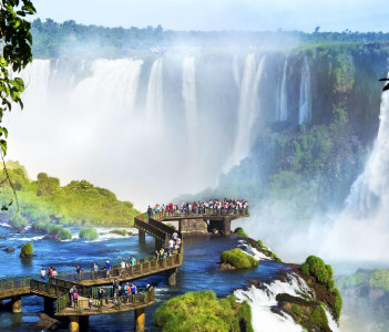 Tourists at Iguazu Falls, one of the world's great natural wonders, on the border of Brazil and Argentina
