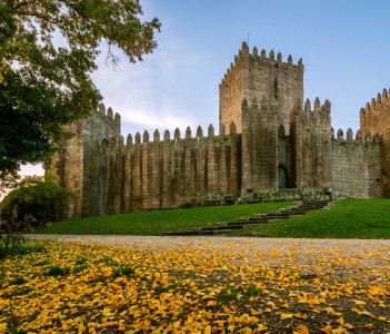 End of a sunny day in the autumn next to the castle of Guimaraes, Portugal